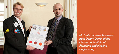 Mr Teale receives his award from Danny Davis, of the Chartered Institute of Plumbing and Heating Engineering